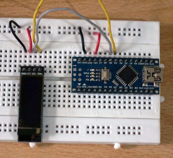 "Arduino Nano di breadboard dengan OLED 0.91"""