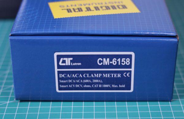 Kotak CM-6158 warna biru dengan latar belakang cutting pad